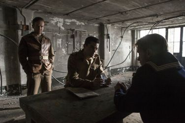 Picture shows: Sergeant Dixon (DEAN LENNOX KELLY) and Ian Fleming (DOMINIC COOPER) in the Interrogation room