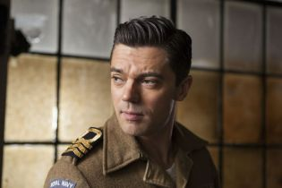 Picture shows: Ian Fleming (DOMINIC COOPER) Interrogation room corridor