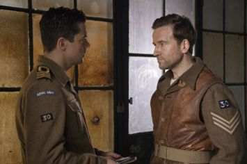 Picture shows: Ian Fleming (DOMINIC COOPER) and Sergeant Dixon (DEAN LENNOX KELLY). Interrogation room corridor